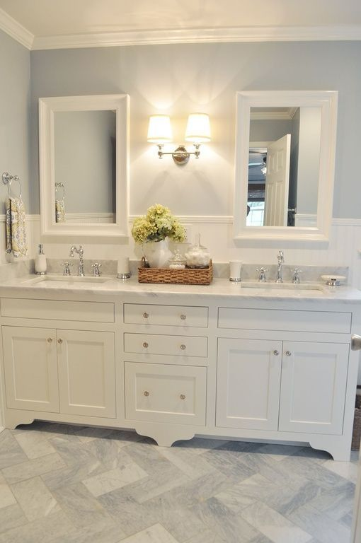 Traditional Master Bathroom with footed cabinetry and herringbone tile floor. #bathrooms #bathroomdesigns homechanneltv.com