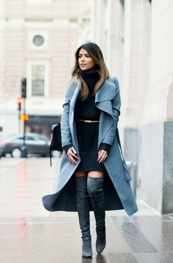 Pam Hetlingeris wearing thigh high boots with a gorgeous pale blue maxi coat and a cute cable knit sweater dress. Wearing a mini belt around a dress like this will clinch your waist and accentuate your curves!Coat: Missguided, Dress: Asos, Boots: Stuart Weitzman.