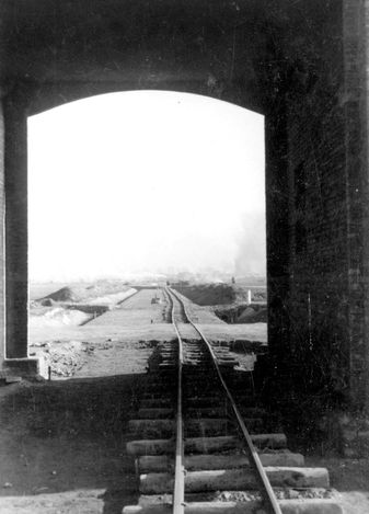 In spring 1944 Germans decided to build a rail line directly into the Auschwitz II-Birkenau camp to. They were getting ready to the biggest mass killing operation in Auschwitz - liquidation of Hungarian Jews. This picture shows the building process of the unloading ramp in Birkenau.