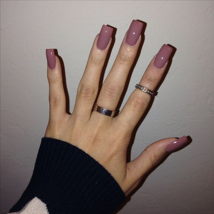 Long square acrylic nails.