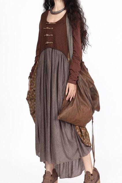 I like this; the longer skirt, the shorter, shaped sweater, and the tremendous bag!  Mori kei