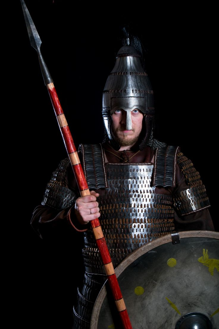 «Langobards warriors».     Langobard warrior with Avar lamellar helmet and lamellar armour, reconstruction based on findings in Niederstotzingen (Germany), shield (decorated with motifs from a fibulae found in Cividale del Friuli) and spatha (straight and long sword). Northern Italy, 6th century. Historical reenactment.