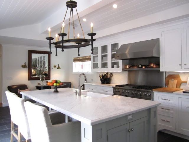 Kitchen - large and open with overstuffed chairs for guests while ...