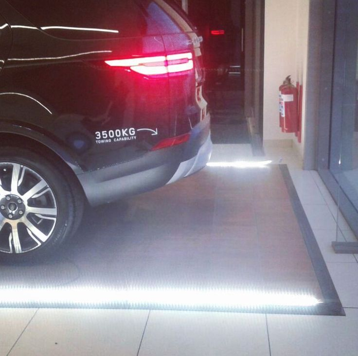 LED strips around a Savannah floor providing a showy surround for the car. #connectafloorcape #eventflooringcapetown