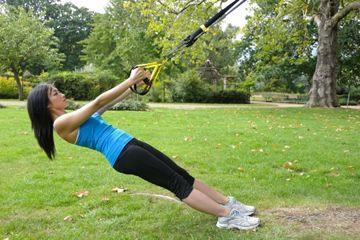 Your Outdoor Circuit: 3 Full-Body TRX Moves - ACTIVE.com. Standing Back Row, Squat to Standing Row, Standing Chest Press,