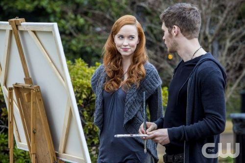 """The Originals -- """"Moon Over Bourbon Street"""" -- Image Number: OR117c_0266.jpg -- Pictured (L-R): Elyse Levesque as Genevieve and Joseph Morgan as Klaus - Photo: Skip Bolen/The CW -- © 2014 The CW Network, LLC. All rights reserved."""