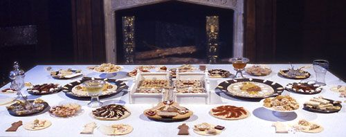 The cold collation, an arrangement of sweet luxury foods. In England this was known in the sixteenth and seventeenth century as the banquet. The table above is a recreation of a banquet of the early Stuart period. There is also a large range of other sweetmeats and preserves including cheesecakes, gilt gingerbreads made in contemporary moulds, candied eringoes, diet bread, banebread, Shrewsbury cakes, cotoniack, wet suckets, comfits, fruit pastes and marmalades.
