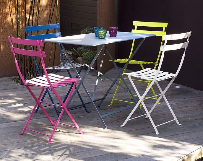 Fermob's Bistro chairs and Oblong table create a pop of color in any outdoor space.
