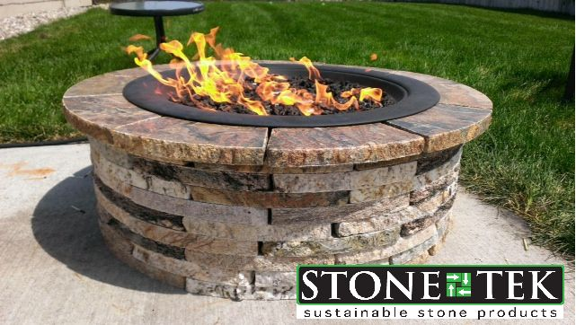 our small round recycled granite fire pit set up for propane more