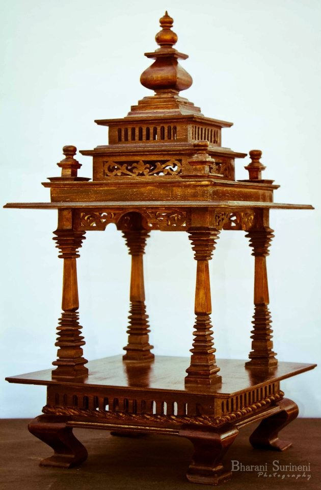 Puja Mandapam-16 Product Code : MM16: This design made in wood reminds of various architechtural marvels of India in its pillars. This item is available in 3 sizes, Small(Price : Rs.4000, medium(which is of regular size around 2 ft of dimensions- Price : Rs.9000 & large. This item is done in specially created shade of wood polish to give the feeling of tradition. the same item can be done in any other paint or polish shade as selected by the customer.