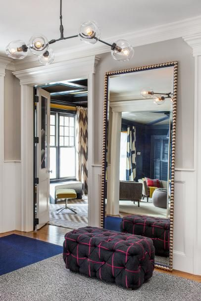 Foyer Features Full Length Mirror & Tufted Ottoman