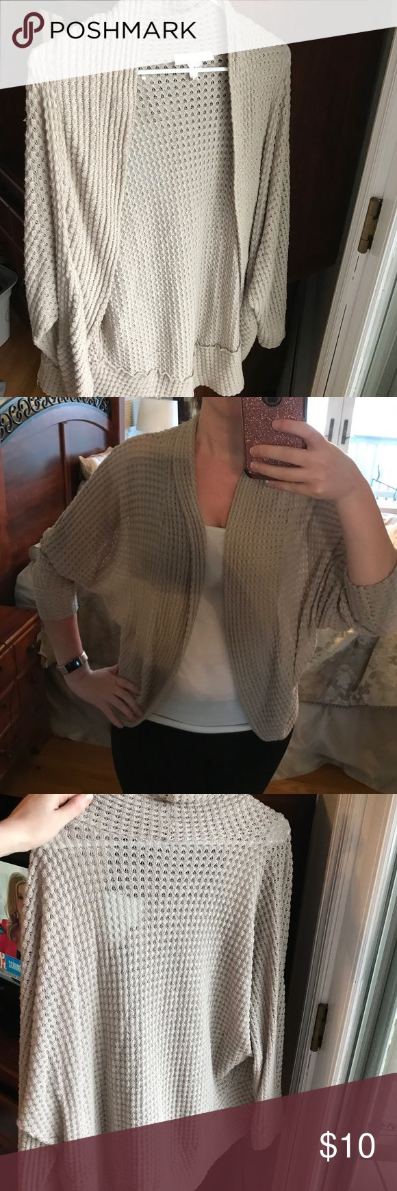 Nude cardigan Comfortable cardigan! Matches with almost everything with the nude/tan color! Sweaters Cardigans