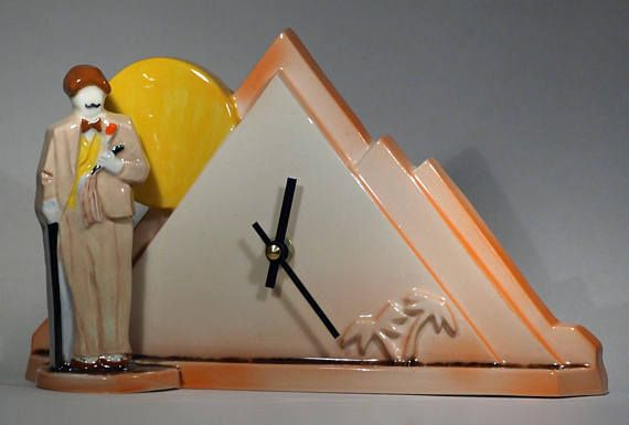 This is a stylish and attractive ceramic Mantel clock in an Art Deco Inspired Hercule Poirot Death On the Nile design. This clock has been hand glazed in a combination of our own amber sunrise glaze with contrasting hand decorated orange, grey, yellow, brown and black glaze detail. The