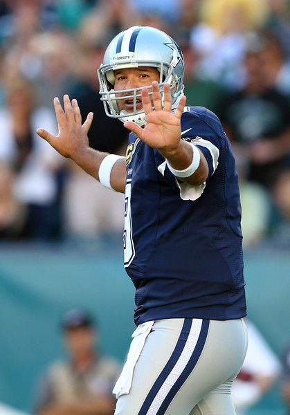 Tony Romo Photos Photos - Tony Romo #9 of the Dallas Cowboys calls out the play in the first quarter against the Philadelphia Eagles on September 20, 2014 at Lincoln Financial Field in Philadelphia, Pennsylvania. - Dallas Cowboys v Philadelphia Eagles