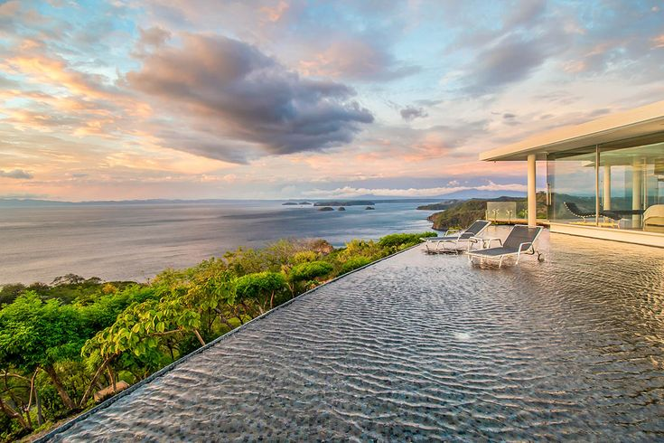 Like the islands in the bay visible from its windows and terrace, Villa Nova ins Costa Rica is surrounded by water, set in a soothing water feature and infinity pool. A shallow platform in the pool lets you set up lounge chairs and dip your toes in the water while watching the sun set over the Pacific.