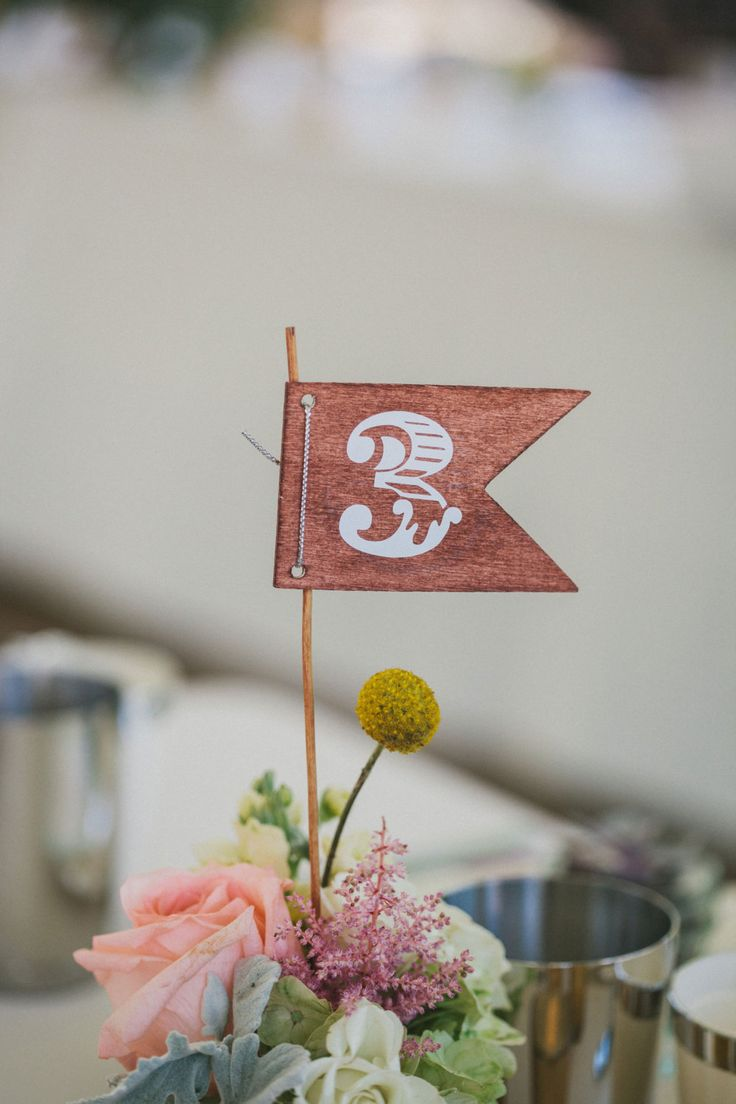 Don't you just love these little table numbers? | Vinyl Table Numbers | Rustic Table Numbers | DIY Table Numbers | Unique Table Numbers | Wedding Ideas | Rustic Wedding | Pennant Flag Wedding Ideas | Pennant Flag Table Numbers | #tablenumbers #weddingideas