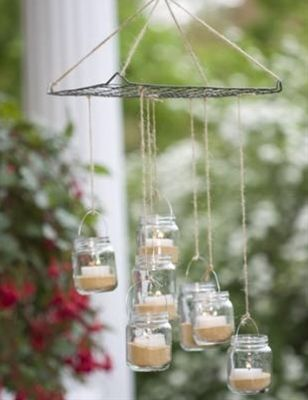 Mason jars-Baby food jar outdoor chandelier -- this is adorable!  I think itd be a good craft w/the kids too.  Maybe do colored sand and even those battery operated tea lights from the $ store? - Click image to find more Home Decor Pinterest pins