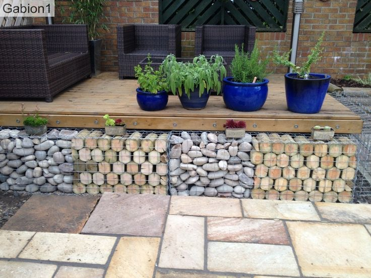 stone and log filled gabions in co durham garden        gabion1 co uk
