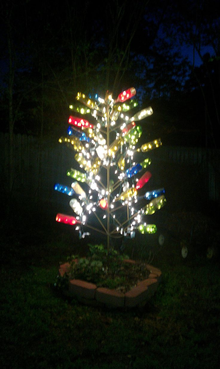 My bottle tree.  Tree made of rebar, a variety of colored bottles, 9 strands of 50 count LED lights, on a timer, electricity from extension cord buried underground in outdoor pvc pipe.