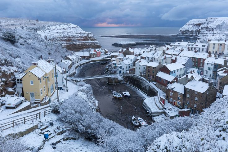 STAITHES, ENGLAND  - FEBRUARY 27: Snow covers the Yorkshire Coast on February 27, 2018 in Staithes, United Kingdom. Freezing weather conditions dubbed the 'Beast from the East' brings snow and sub-zero temperatures to the UK. (Photo by Tom White/Getty Images) via @AOL_Lifestyle Read more: https://www.aol.com/article/weather/2018/02/27/two-killed-as-snow-sub-zero-temperatures-paralyze-europe/23372536/?a_dgi=aolshare_pinterest#fullscreen