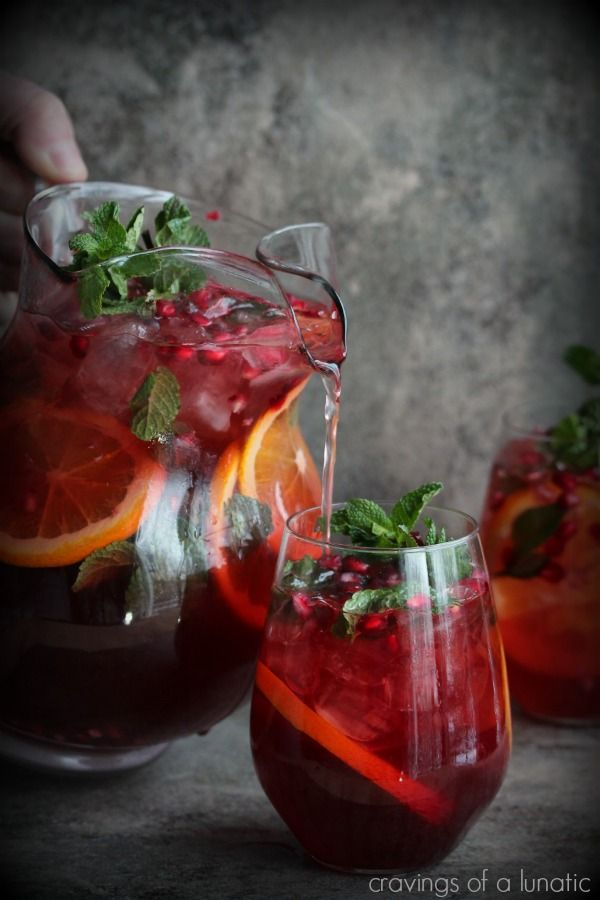 Pomegranate Party Punch by cravingsofalunatic:Perfect for parties, you can spike one batch and leave the other unspiked. #Punch #Pomegranate