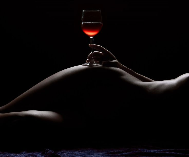 Woman naked with a glass of wine gothic