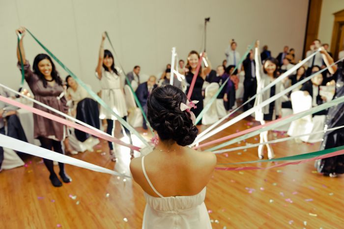 I like this alternative to throwing the bouquet: all the girls get a ribbon, and when the bride drops the bouquet, everyone finds out who gets the bouquet because her ribbon will be tied to it.