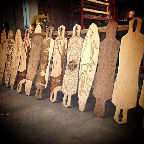 AMAZING WORK DONE IN OUR HOME TOWN. CUSTOM LASER ETCHED LONGBOARDS BY SCAM SKATE IN WINNIPEG, MB