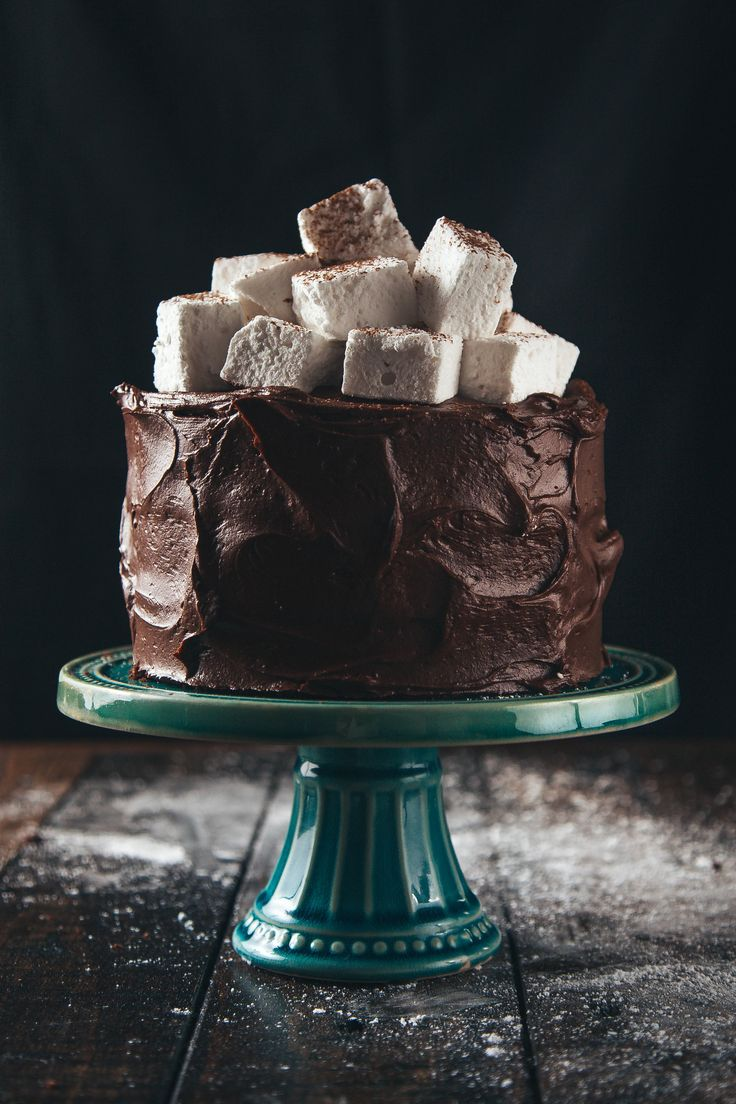 Triple-Layer Hot Chocolate Cake, my fiancé's favorite cake! I add some marshmallows inside the batter too while it bakes and a tiny pinch of cinnamon!