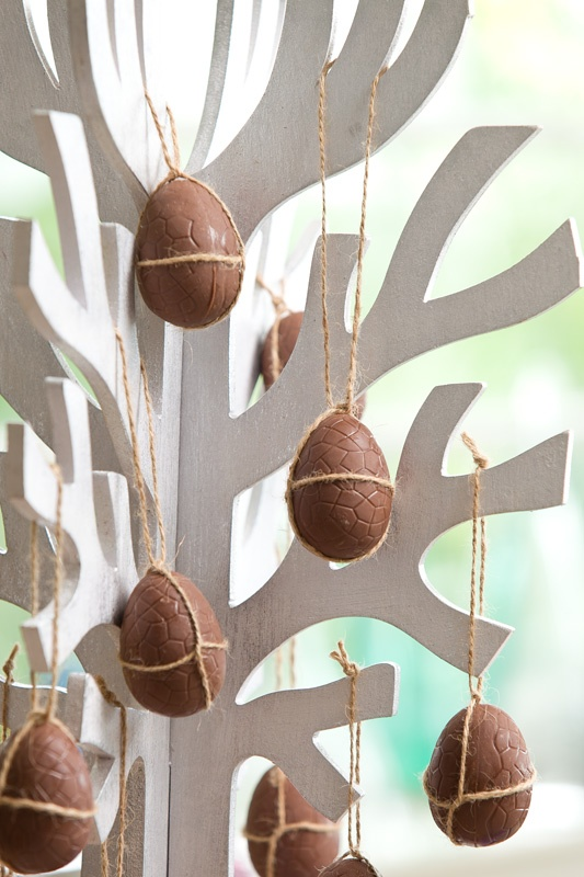 Decorate this Easter:  Wooden tree - Loot Homewares $30 & assorted chocolate eggs from Brook Nextra News.
