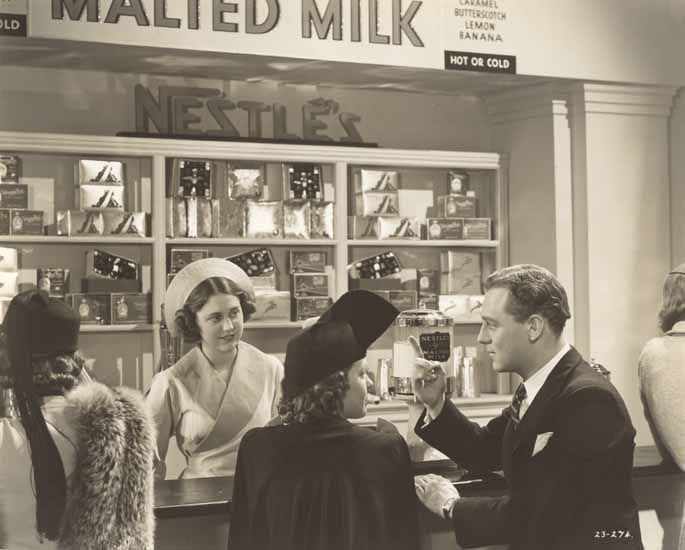 DAD AND DAVE COME TO TOWN : MILK BAR SCENE; SHIRLEY ANN RICHARDS (JILL, C) AND BILLY RAYES (JIM BRADLEY, R) ORDERING A MILK SHAKE AT THE 'REGAL' MILK BAR