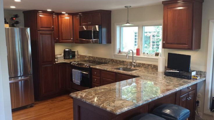 Traditional Kitchen with Breakfast bar, Marble.com Cedar Marble, Athens Cabinetry, Pendant Light, Complex granite counters