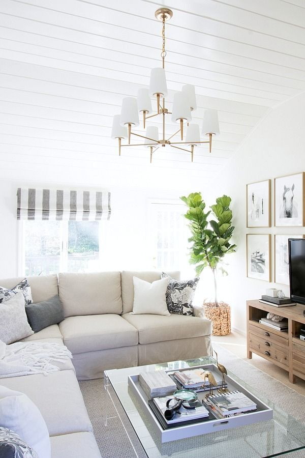 Family Room In Neutrals With Slipcovered Sectional Acrylic Coffee Table And Two Tiered