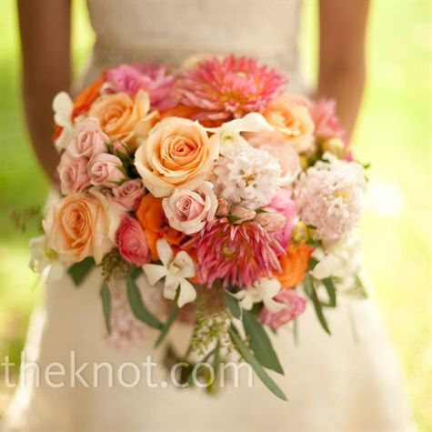 orange, peach, pale pink, and green flowers (roses, dahlias, ranunculus, hyacinths, and hydrangeas)