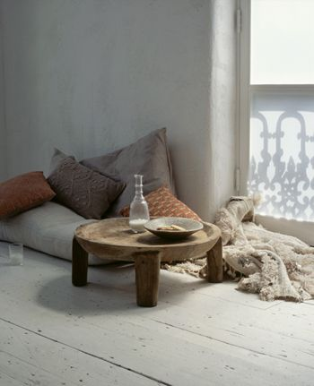 low tea table, floor cushions, cozy throw. May make the log table from the cake stand.