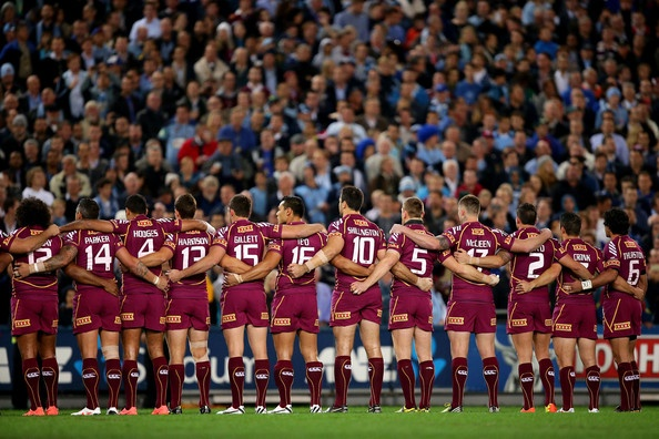 The Maroons lineup and sing the national anthem before game one of the ARL State of Origin series between the New South Wales Blues and the Queensland Maroons at ANZ Stadium on June 5, 2013 in Sydney, Australia.