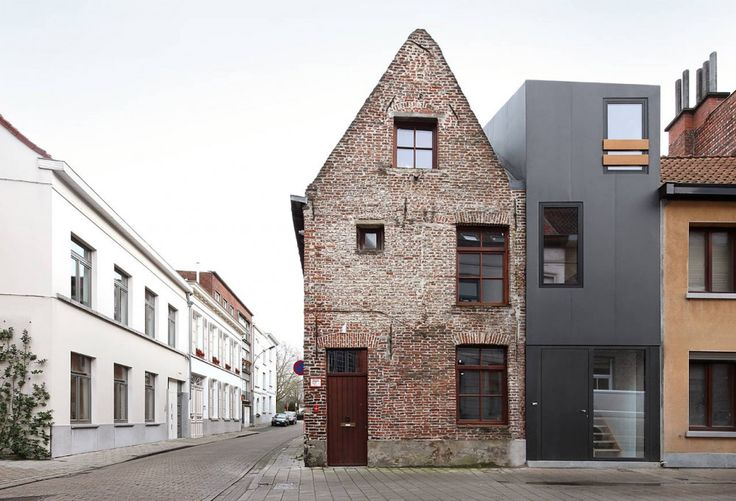 Gelukstraat / Dierendonck Blancke Architecten : the wooden window detailing and the stair window save this facade from sterile industrial