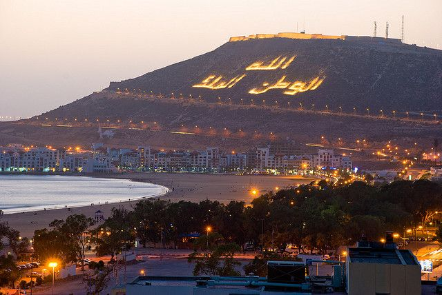 The beautiful beach of Agadir, Morrocco writing translated, God, King and country