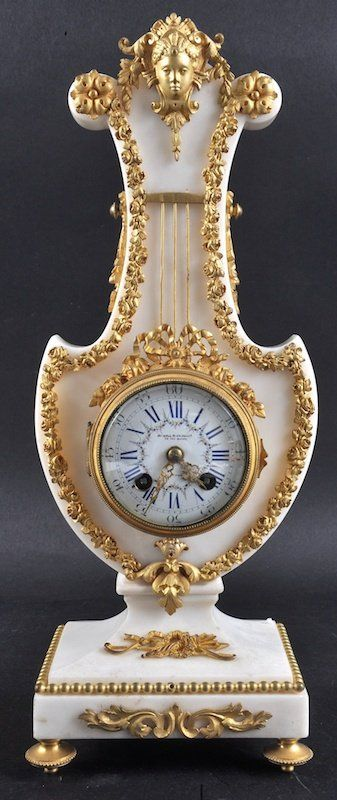A Good 19th Century French White Marble Lyre Clock Retailed by Howell & Jones.