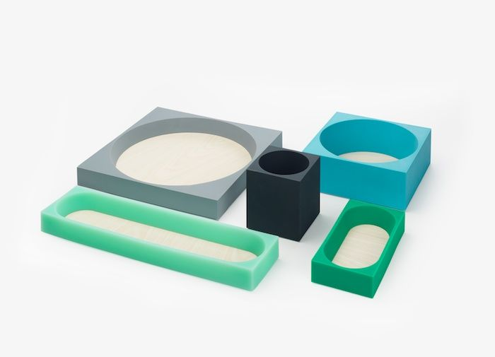 "Euclid by Tomas Alonso | ""A series of desk trays for PRAXIS, combining rubber in different colours with ash. Based on Euclid's theories of the relationship between the square and circle, the complementary sizes allow them to stack or sit individually on any desk."""
