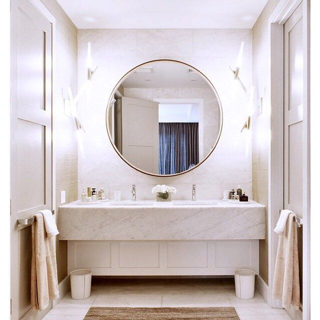 """Thanks so much to @sarahsarna for featuring our Gramercy Loft in """"10 Beautiful Bathrooms with a Round Vanity Mirror"""" // photo by @emily__andrews #dhdnyc #dhd #davidhowelldesign #loft #nyc #vanitymirror #roundmirror #masterbath #neutral #gramercypark #newyork #manhattan #gramercy #home #dhd #davidhowell #steffaniaarons #interiordesign #interiors #architecture #architect #interiordesigner #design"""
