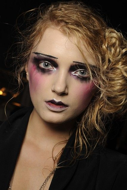 Spring/Summer 2010 John Galliano Expertly-smudged eyes with metallic detailing, purple shading on the cheeks and defined lips created the head-turning beauty look at John Galliano. Photo By FirstVIEW
