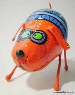 super cute dog sculpture...paper mache ... We could use all those coconuts I have !!!!