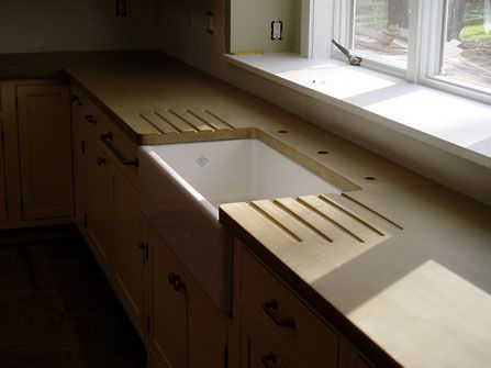 Concrete countertop with white farmhouse sink Home improvements ...
