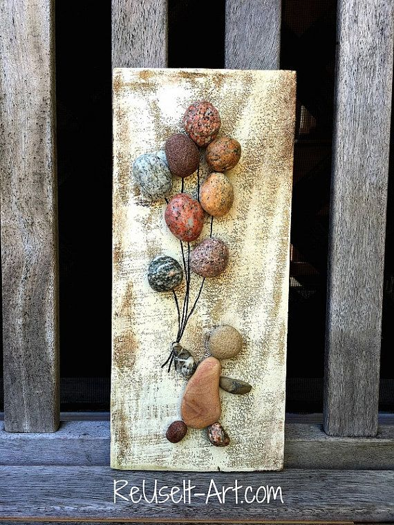 ReUse It Art™ handcrafts & upcycles wooden pallets into stunning wall decor. Wood signs may be fully customized. Seaglass, river rock, wine corks and driftwood may also be found in our one of a kind creations. All original wood pieces are crafted with care and pride. I make each piece as if it were my own. Rock Art Wood Sign Details:  - Distressed Cream background with Rocks in shape of a kid holding balloons. - Rocks are safely and permanently adhered using industrial grade glue. -Each sign…