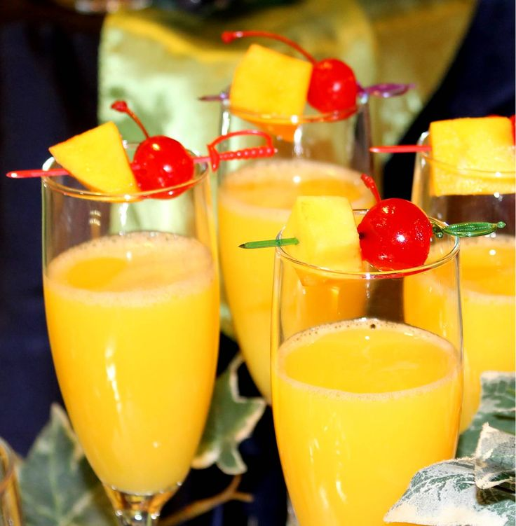 Hawaiian Mimosas - Champagne and orange-pineapple juice, garnished with fresh pineapple and a stemmed cherry. Very refreshing and perfect for a Sunday brunch, a weekend breakfast, or on New Year's morning. #Champagne #Brunch #Mimosas