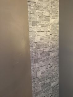 how to create a beautiful accent wall using wallsrepublic wallpaper, how to, wall decor, First strip of paper on old wall
