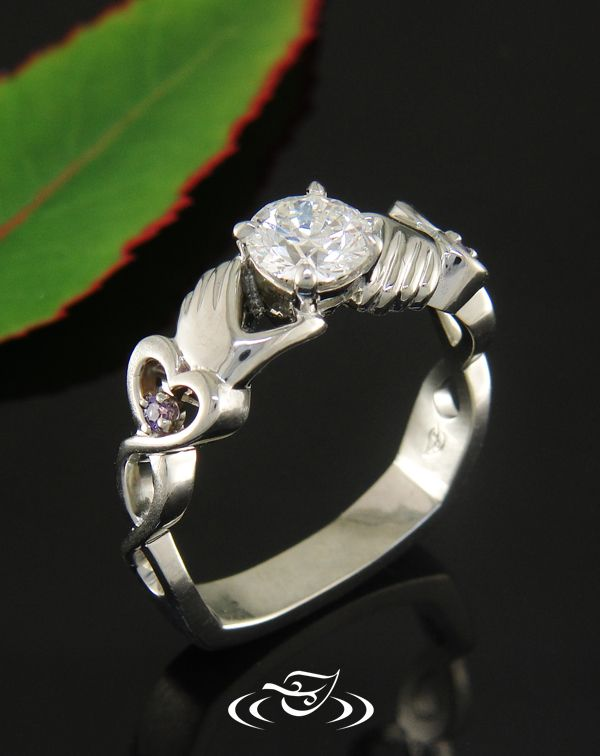 White gold #claddagh inspired ring to holds a brilliant cut #Diamond. #GreenLakeJewelry