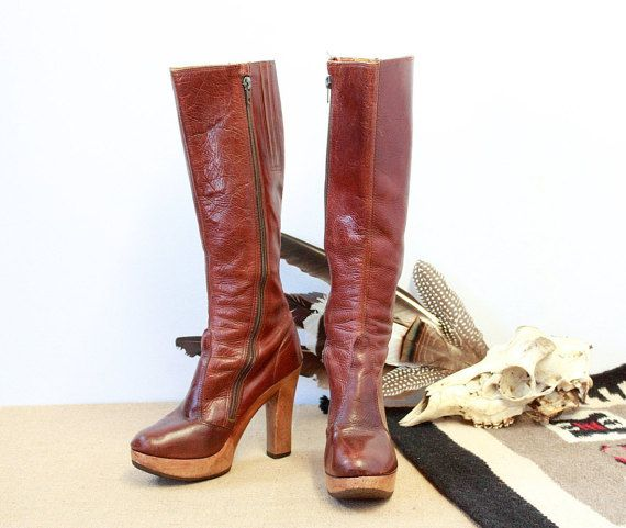 RE-BOOT Get a little higher with these super terrific boots. DESCRIPTION: • knee high • platform heels • elasticized top gore • slender and shapely • soft round toe • zippers for easy on & off CIRCA: 1970s  LABEL: Sbicca  SIZE: 6.5 heel: 4 1/4 sole length: 8 sole width: 2 1/2 height: 17 1/2 boot opening: 13  MATERIALS: leather, wood, rubber COLOR: cognac brown CONDITION: great! gently worn. no flaws to note.