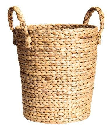 Beige. Large storage basket in thick, braided water hyacinth with two handles at top. Height 14 1/4 in., diameter at top 11 3/4 in.